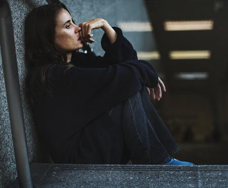 Woman Sitting Look Worried on The Stairway