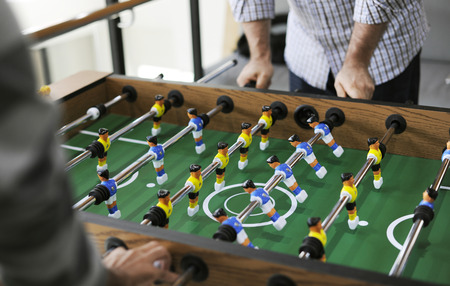 People playing table football Foto de archivo
