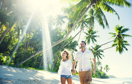 Couple relaxing at a beach in Samoa Stock Photo