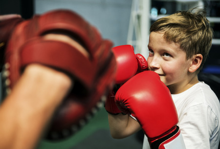 Boy Boxing Training Punch Mitts Exercise Concept Stock Photo - 90761317