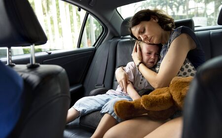 Mother consoling her crying son in the car Reklamní fotografie