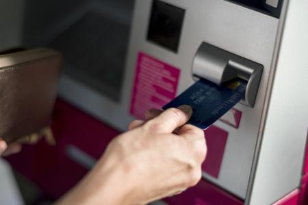 People withdraw money using machine Stok Fotoğraf