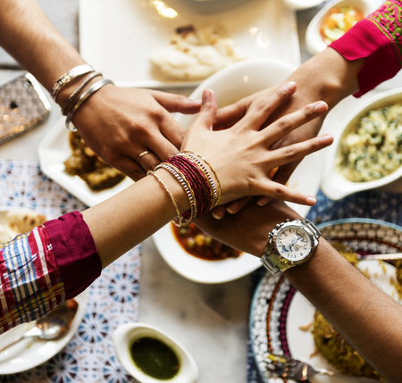 A group of Indian people is having lunch together Banco de Imagens