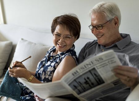 Senior Couple Read Newspaper Crochet