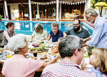 Group of diverse people enjoying barbecue party together Standard-Bild