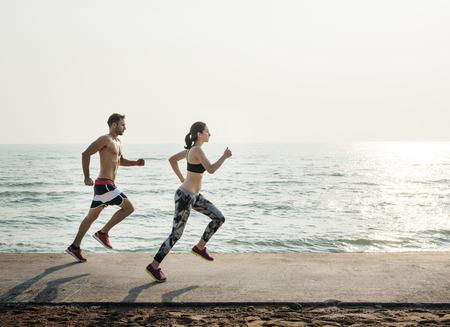 Couple Running Outdoors Beach Concept