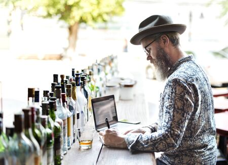 Restaurant owner doing inventory in the bar