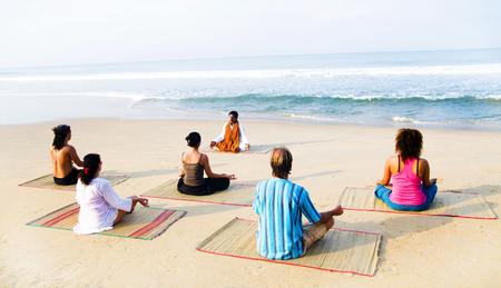 Healthy yoga class by the beach.