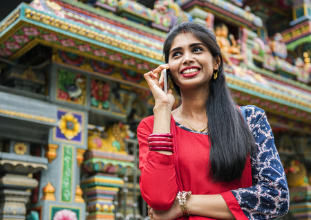 Indian people using mobile phone Stock Photo