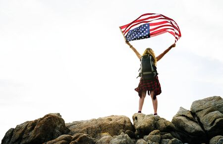 Caucasian woman holding American flag Stock Photo - 94959882