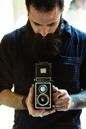 Photographer using a vintage camera Stock Photo