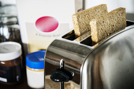 Bread being toasted Stock Photo