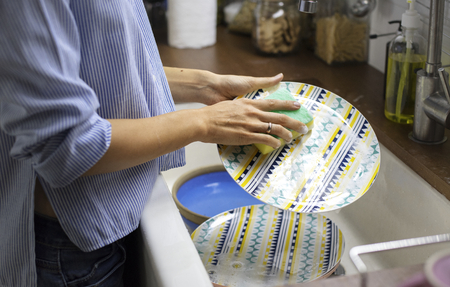 Woman cleaning dishes