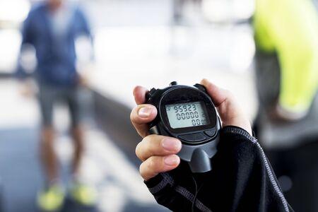 Closeup of hand holding stopwatch 版權商用圖片