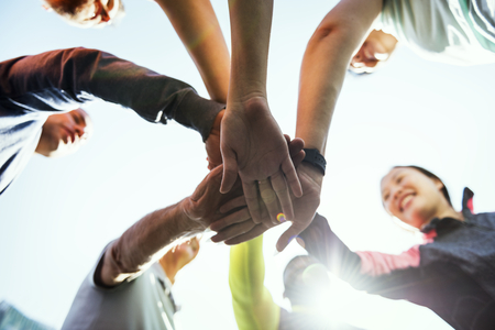 Diverse people joined hands together Stock Photo - 95014748
