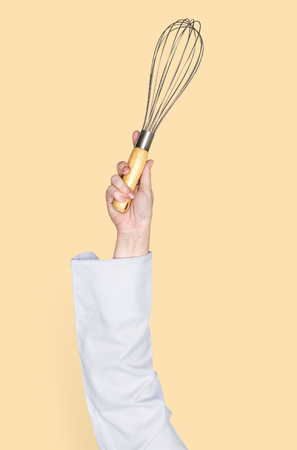 Person holding a balloon whisk