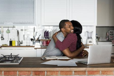 Black couple hugging together