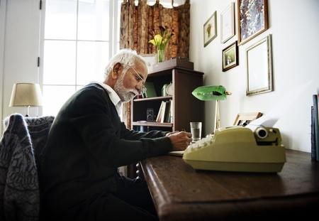 Seniore man writing