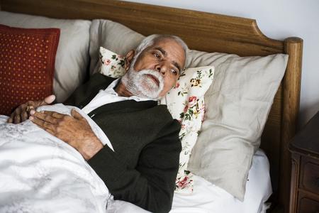 老人ホームで年配のインド人男性 写真素材