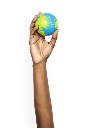 Person holding a small globe