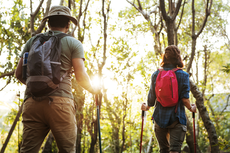 Man and woman going for a hike in the woods