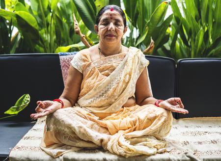A meditating Indian woman Фото со стока