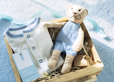 Baby clothes and toy Stock Photo