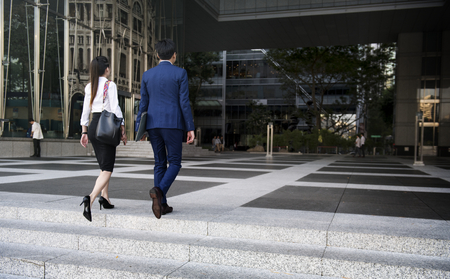 Businessman and woman walking Stock Photo