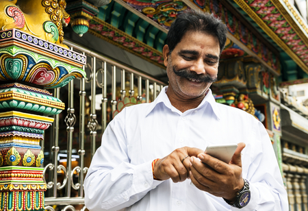 Indian man using his mobile phone