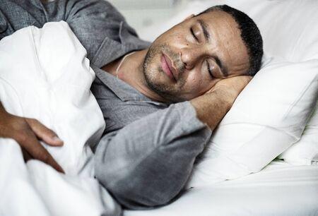 A man sleeping on a bed 版權商用圖片