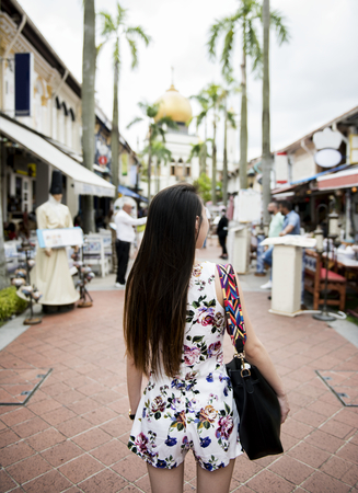 Rear view of Asian woman in the street