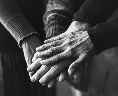 Hands holding together in black and white