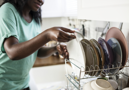 Black woman washed the dishes