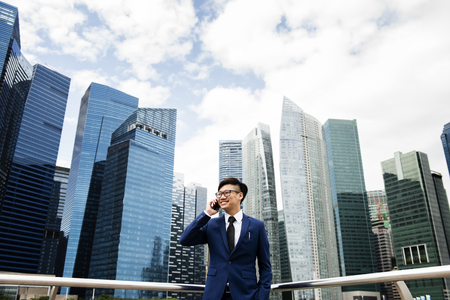 Asian businessman in a city Stock Photo - 95112656
