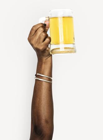 Hand holding a mug of beer