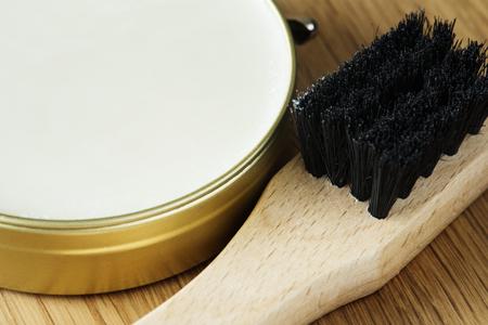 Closeup of shoe brush and polish Stock Photo