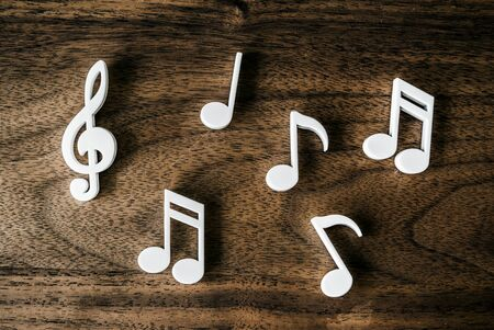 Music icons on wooden background 写真素材 - 95597982