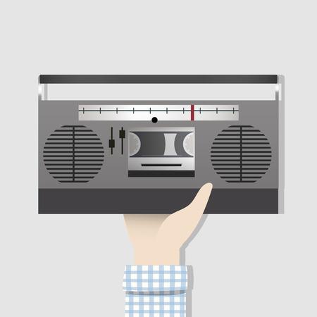 Hand holding a radio