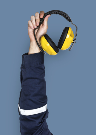 Hand holding a headphone