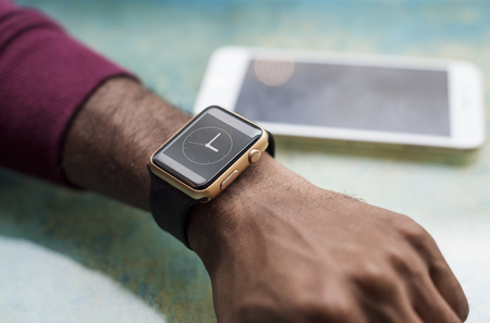 African man wearing a smartwatch Stock Photo