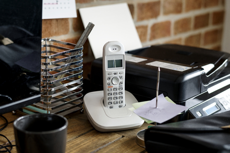 Closeup of landline phone on wooden table