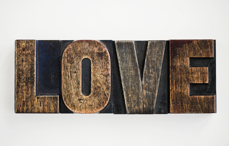 "Closeup of the word ""Love"" isolated on white background"