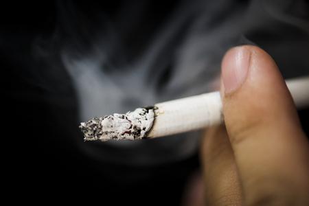 Closeup of hand holding cigarr