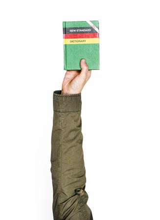Hand holding variation of object Standard-Bild