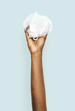 Hand holding a bath sponge Stock Photo