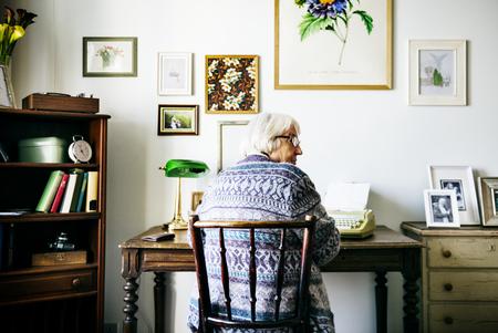 Senior woman writing 스톡 콘텐츠