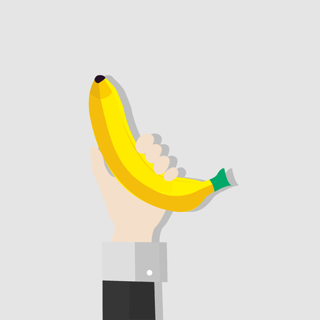 Hand holding a banana Stock Photo