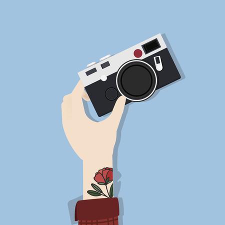 Hand holding a camera Imagens - 115728234