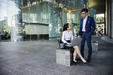 Business people in a city working together 写真素材