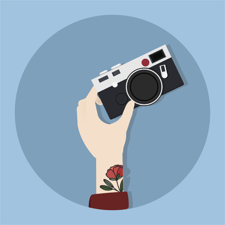 Hand holding a camera concept Stock Photo - 115910791